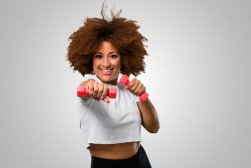 young fitness afro woman exsercising with dumbbells