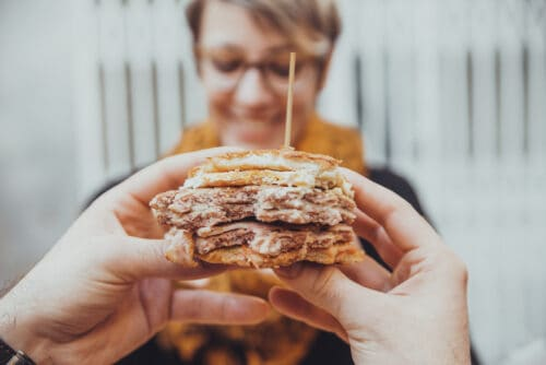 Close Up Of Man Hands Holding Delicious Burger